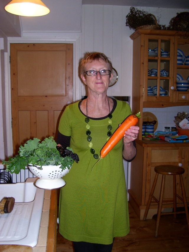 a carrot and kale in the kitchen