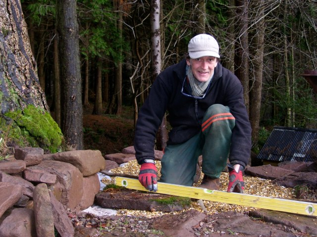 Mick in stone laying action.