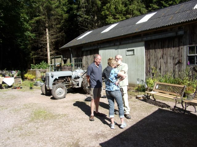 Discussing gardens, tractors and benches!