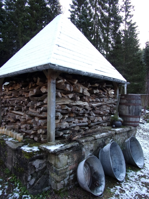 snow-sprinkled wood shed